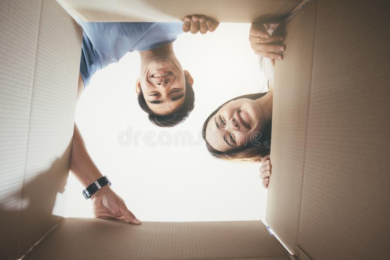 Happy young couple looking inside the box. royalty free stock photos