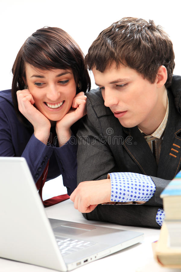 Download Happy Young Couple Looking At Laptop. Stock Photo - Image: 12388530