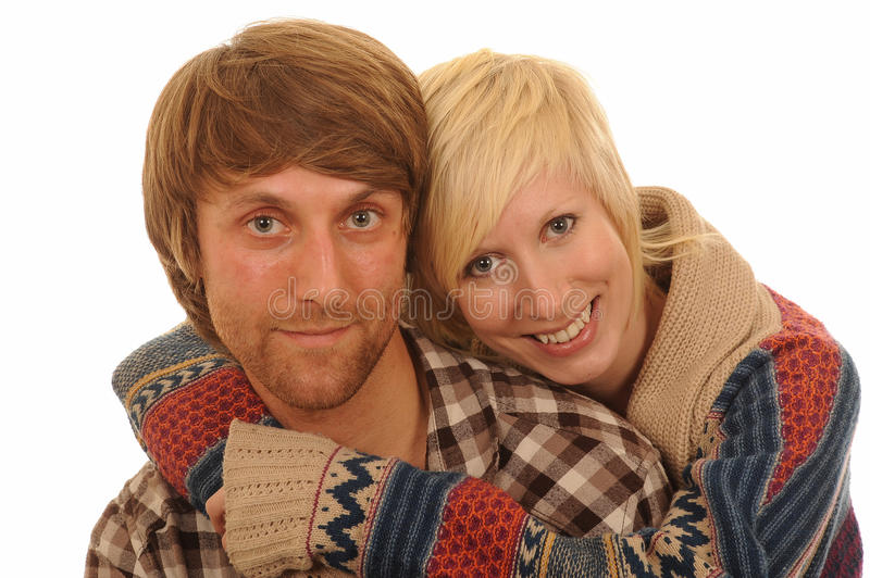 Happy young couple in love. Portrait of happy young couple in love hugging in casual clothes, white studio background stock images