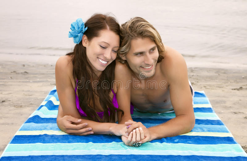 Happy young couple in love at the beach royalty free stock photos