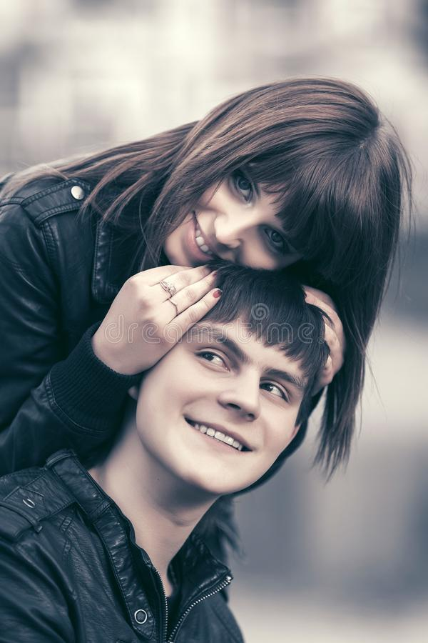 Happy young couple in love hugging in city street stock photos