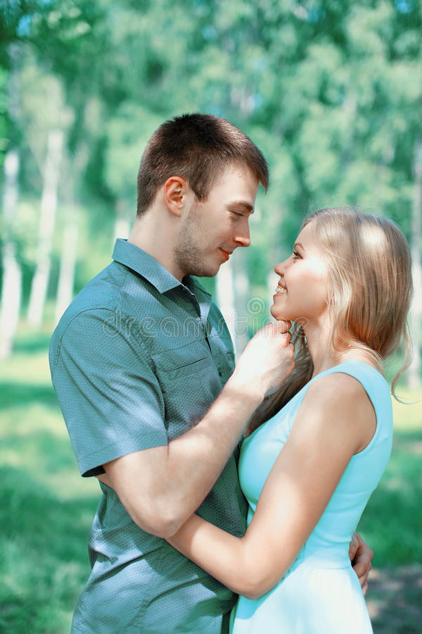 Happy young couple in love, kiss moment royalty free stock images