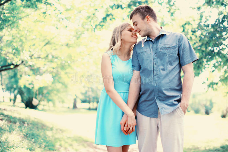 Happy young couple in love together. Outdoors stock photos