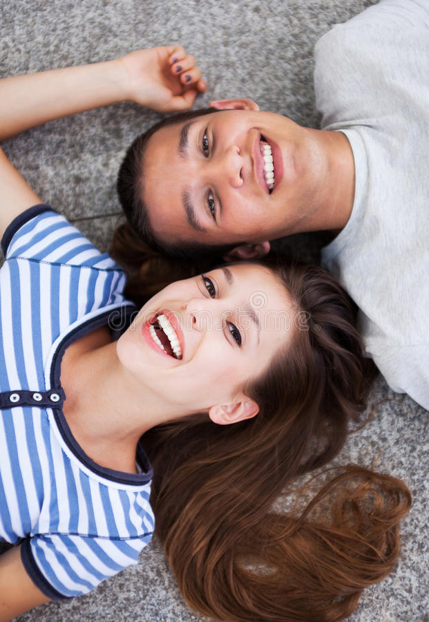 Happy Young Couple Lying Down Stock Image