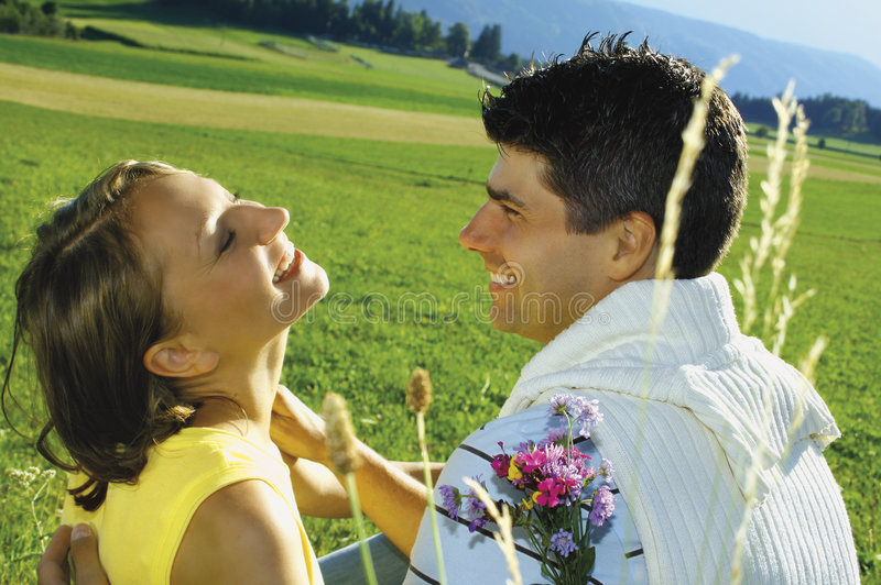 Happy young couple outside stock image