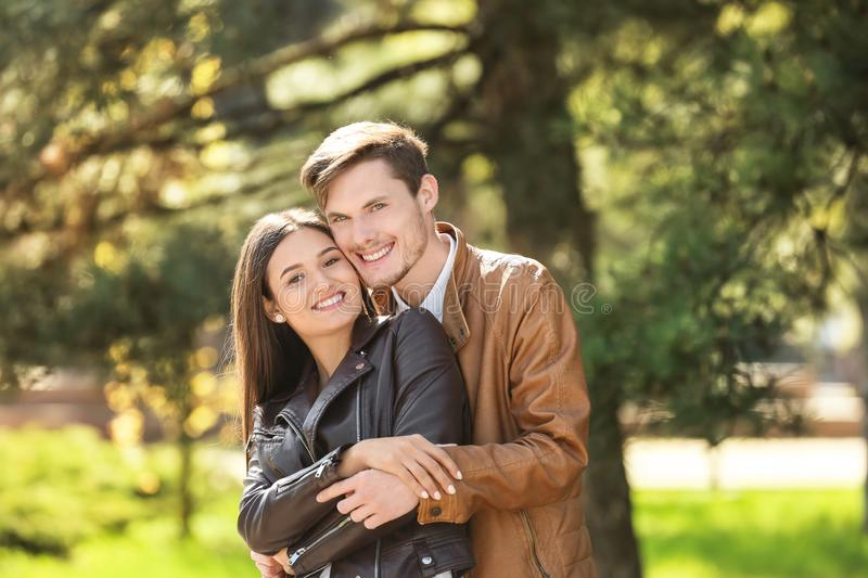 Happy young couple in  park royalty free stock photo