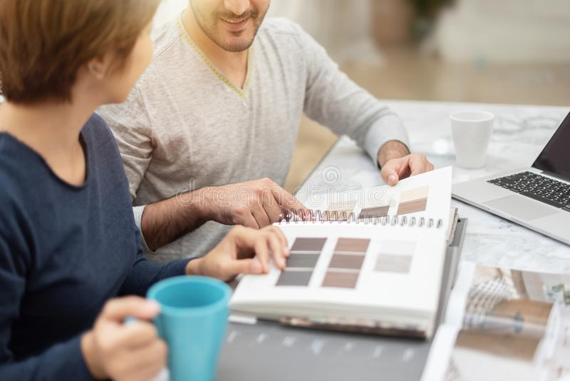 Happy young couple planning to moving to their new house. stock images