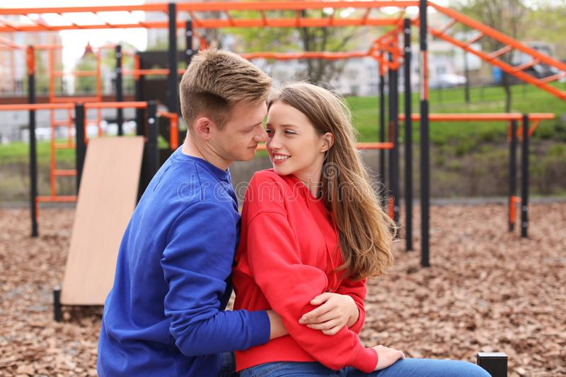 Happy young couple on playground royalty free stock image