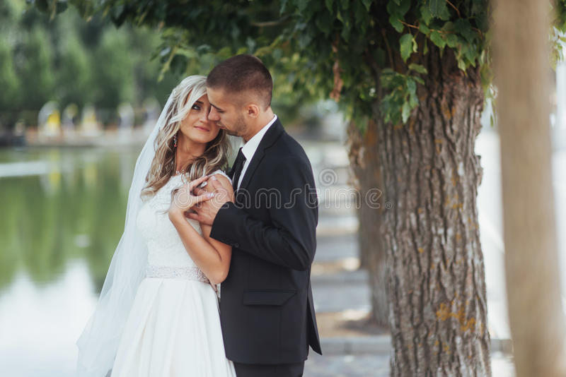 Happy young couple poses for photographers on her happiest day. royalty free stock photos