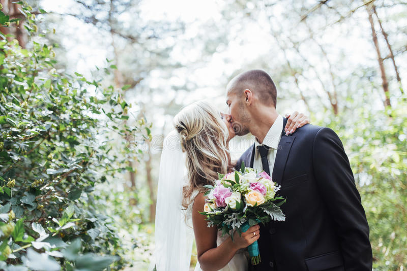 Happy young couple poses for photographers on her happiest day. stock photo
