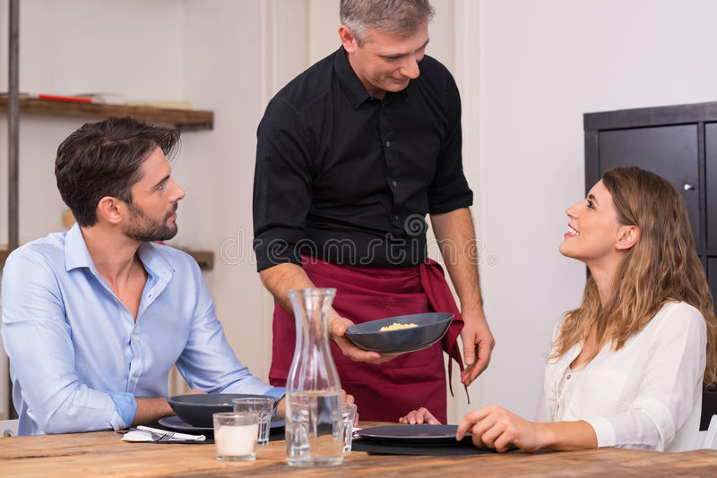Happy young couple at restaurant stock photos