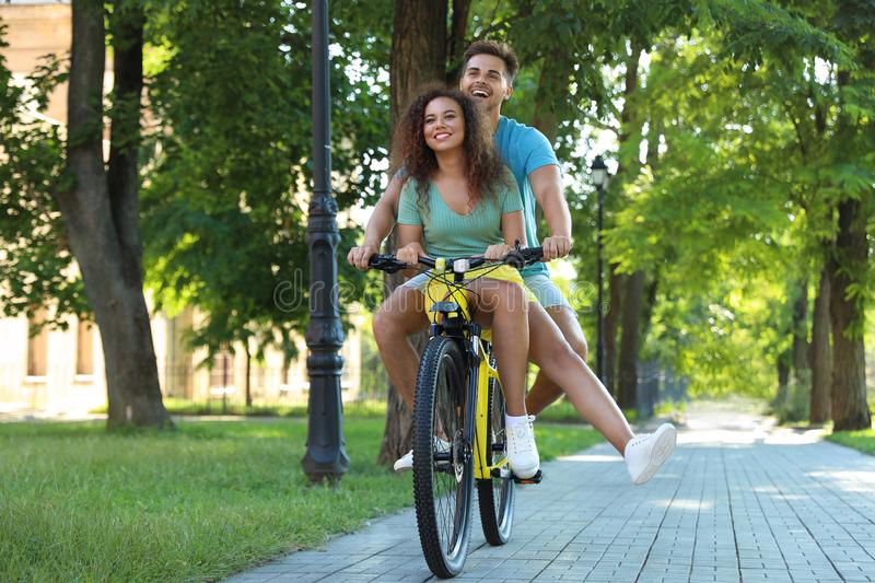 Happy young couple riding bicycle royalty free stock images