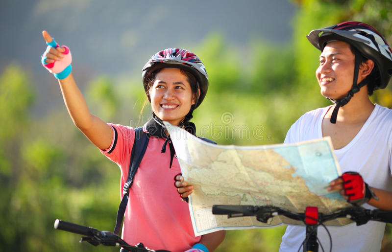 Download Happy Young Couple Riding A Bike Stock Photo - Image: 42345944