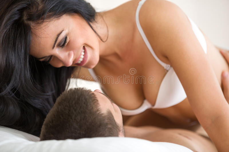 Couple romancing on bed