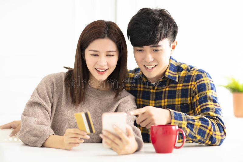 Young couple  shopping online by smart phone. Happy young couple  shopping online by smart phone stock photos