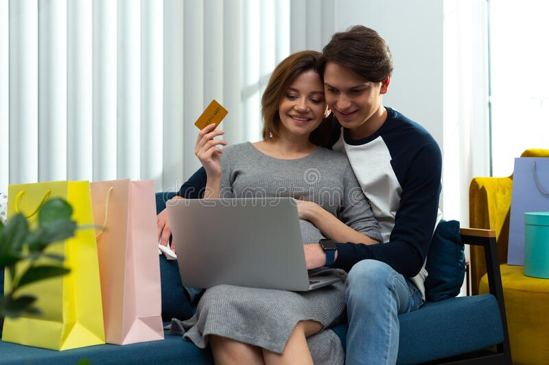 Easy way of buying things in online shopping with gold card royalty free stock photo