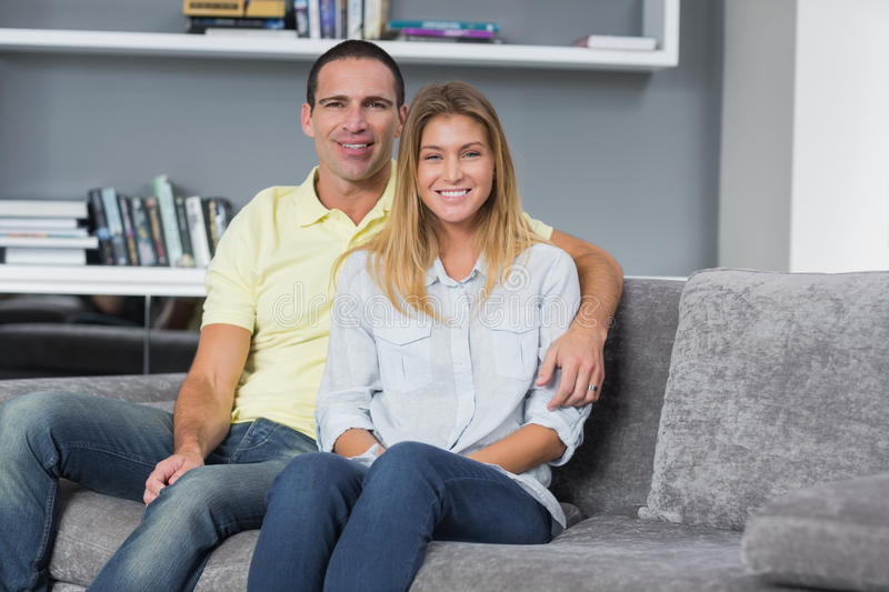 Download Happy Young Couple Sitting On Their Couch Stock Image - Image: 33051535