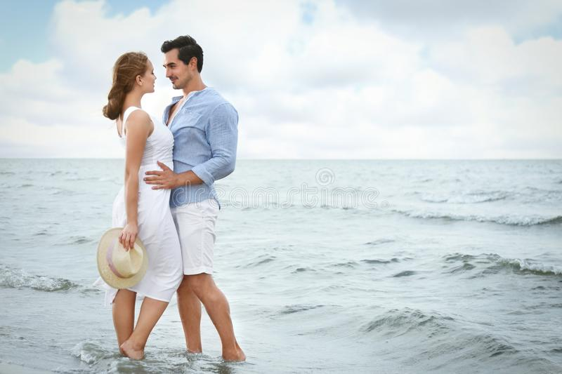Happy young couple spending time at sea stock photo