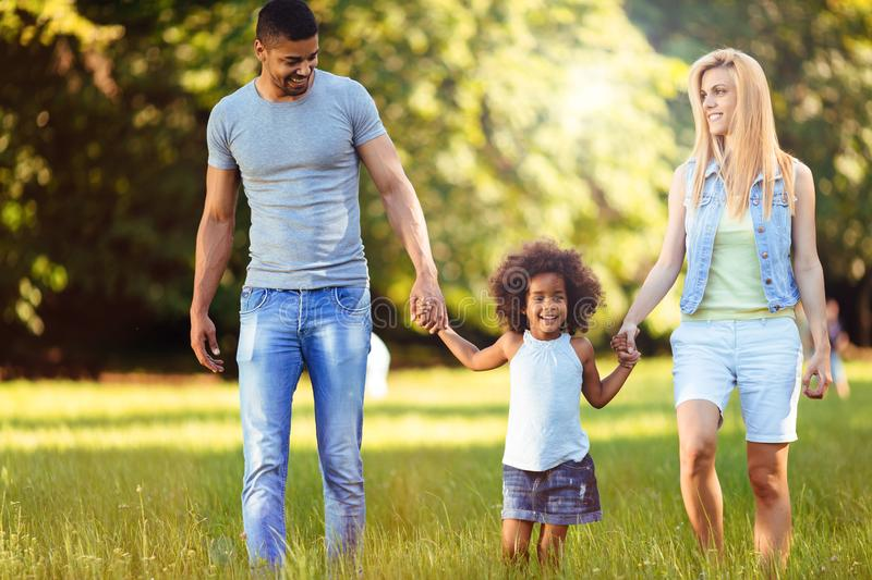 Happy young couple spending time with their daughter stock images