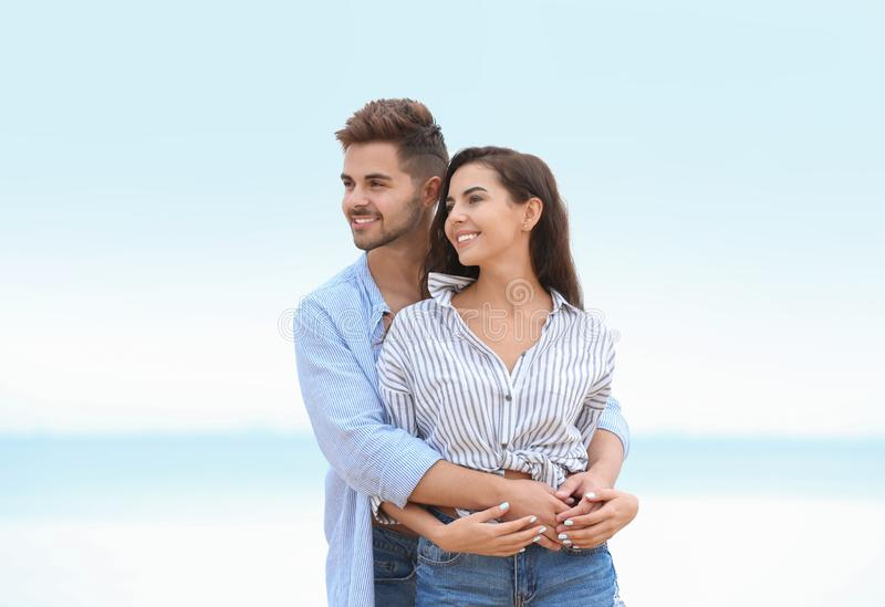 Happy young couple spending  together on beach stock photography