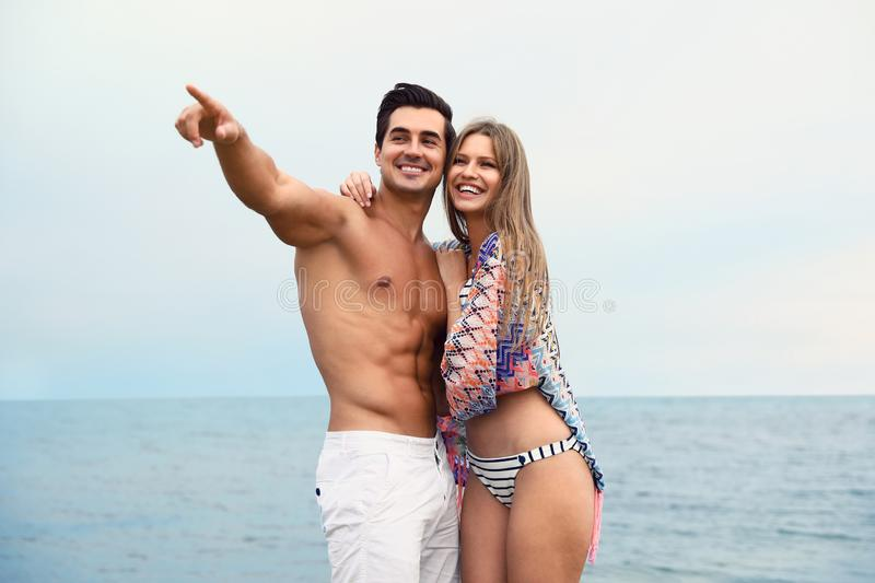 Happy young couple spending time together on sea royalty free stock photo