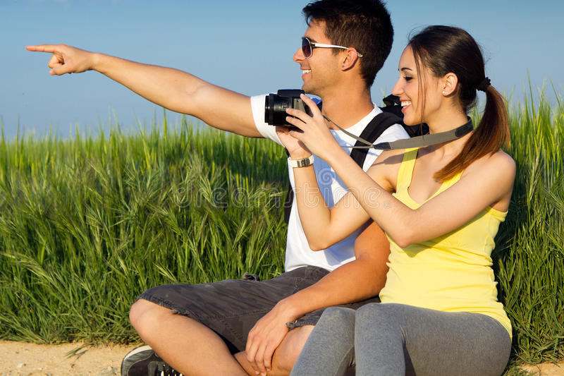 Happy Young couple taking photos in the field stock photo