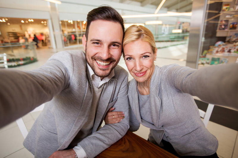 Happy young couple taking selfi royalty free stock image