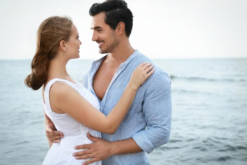 Happy young couple  time at sea beach royalty free stock image