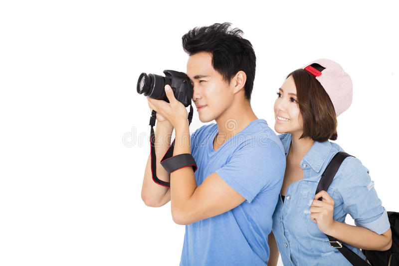 Happy young couple Tourists taking photo stock photo