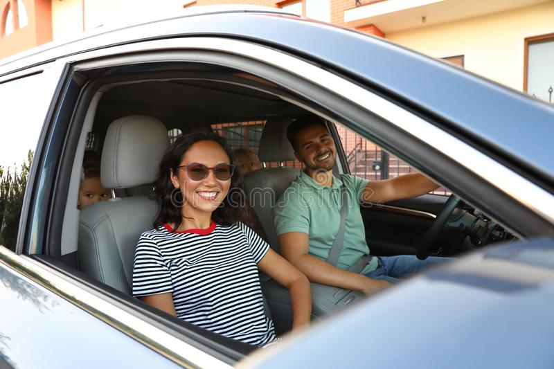Happy young couple traveling by family car royalty free stock photo