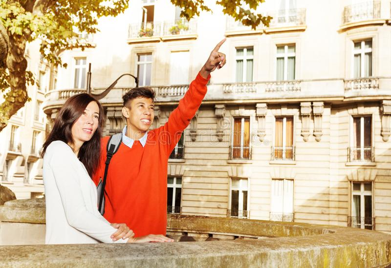 Happy young couple walking along Paris, France royalty free stock photo