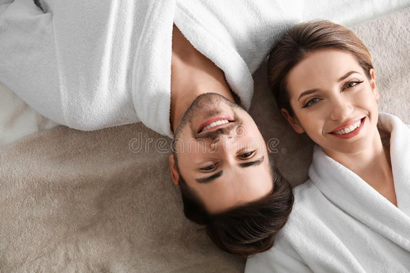 Happy young couple wearing bathrobes. Visit to spa salon royalty free stock photos
