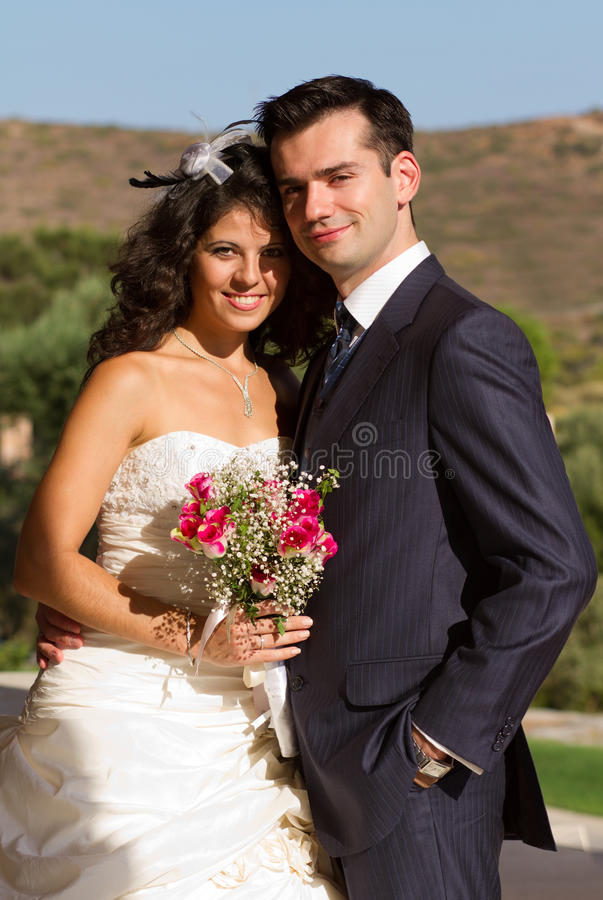 Happy young couple after wedding stock images