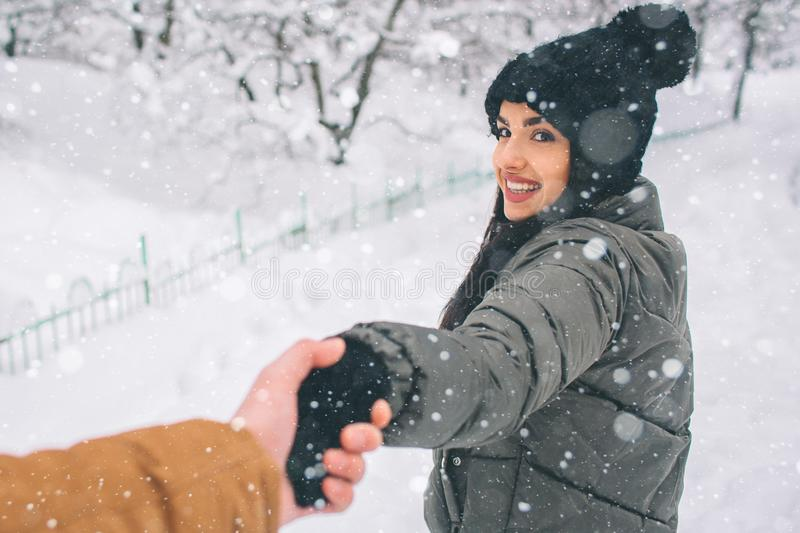 Happy Young Couple in Winter . Family Outdoors. man and woman looking upwards and laughing. Love, fun, season and people royalty free stock photo