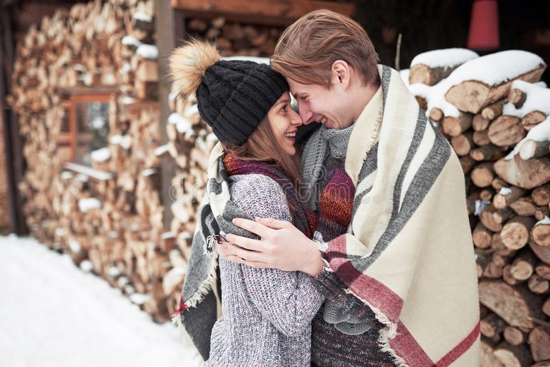 Happy Young Couple in Winter Park having fun.Family Outdoors. royalty free stock photography
