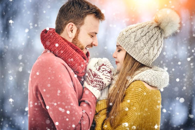 Happy Young Couple in Winter Park laughing and having fun. Family Outdoors. Close up. stock images