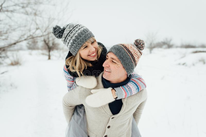 Happy Young Couple in Winter Park having fun.Family Outdoors. love stock image