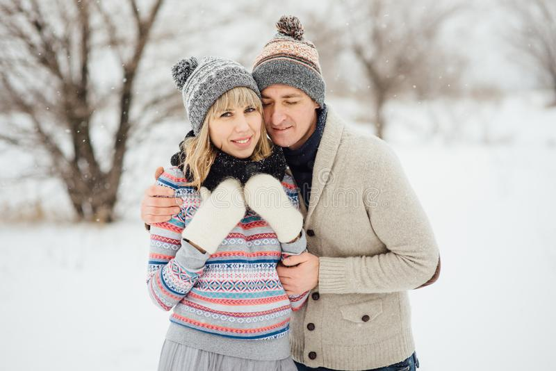 Happy Young Couple in Winter Park having fun.Family Outdoors. love royalty free stock photography