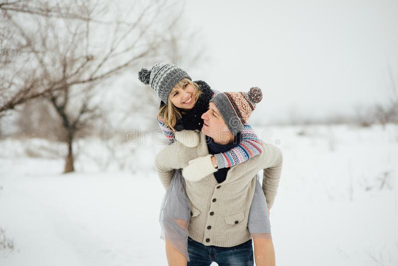 Happy Young Couple in Winter Park having fun.Family Outdoors. love stock photography