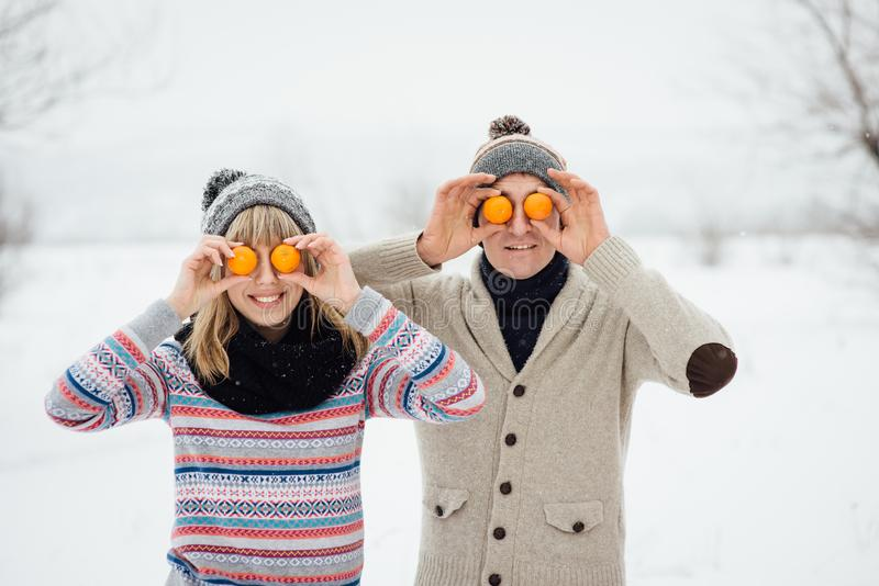 Happy Young Couple in Winter Park having fun.Family Outdoors. love royalty free stock photos