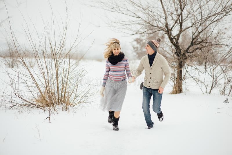 Happy Young Couple in Winter Park having fun.Family Outdoors. love royalty free stock photo