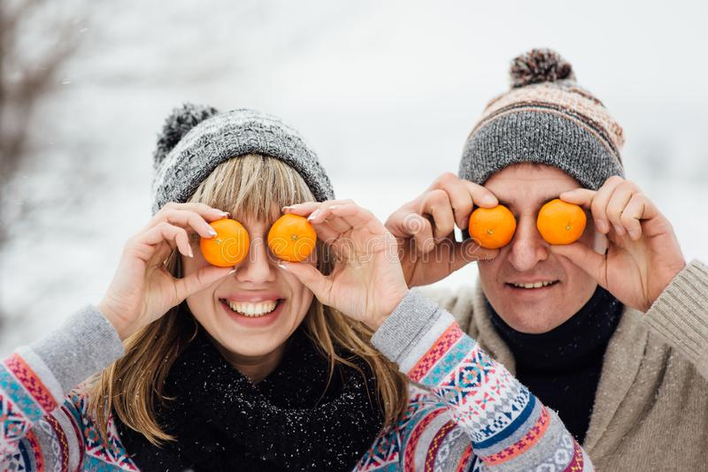 Happy Young Couple in Winter Park having fun.Family Outdoors. love stock images