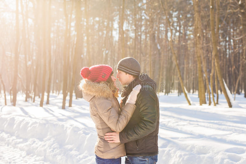 Happy Young Couple in Winter Park having fun. Family Outdoors. love royalty free stock photos