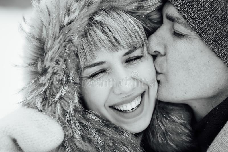 Happy Young Couple in Winter Park having fun.Family Outdoors. love royalty free stock image