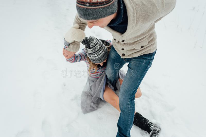 Happy Young Couple in Winter Park having fun.Family Outdoors. love stock photos