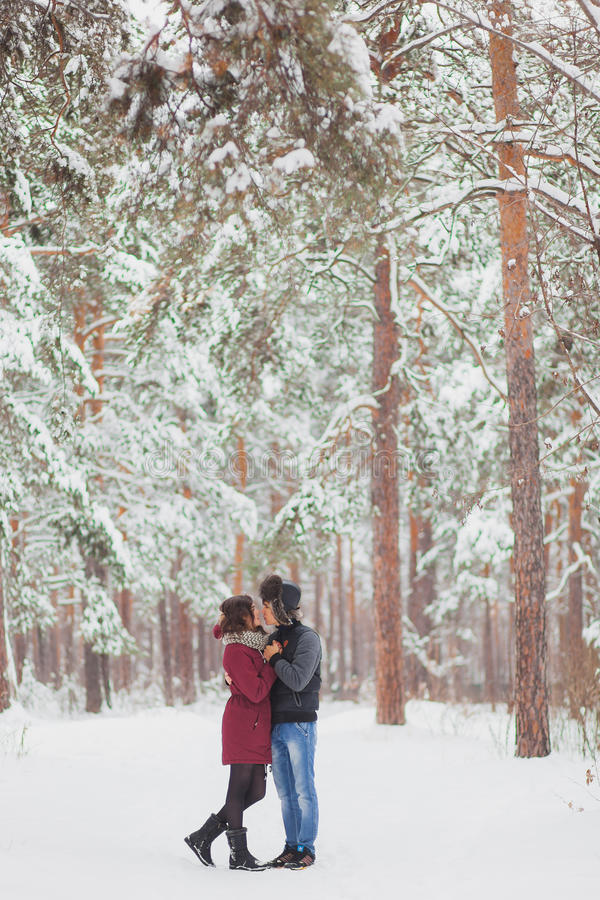 Happy Young Couple in Winter Park having fun.Family Outdoors. love, valentine day royalty free stock photography