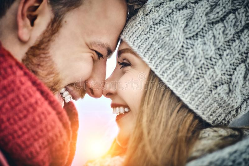 Happy Young Couple in Winter Park laughing and having fun. Family Outdoors. Close up. royalty free stock photo