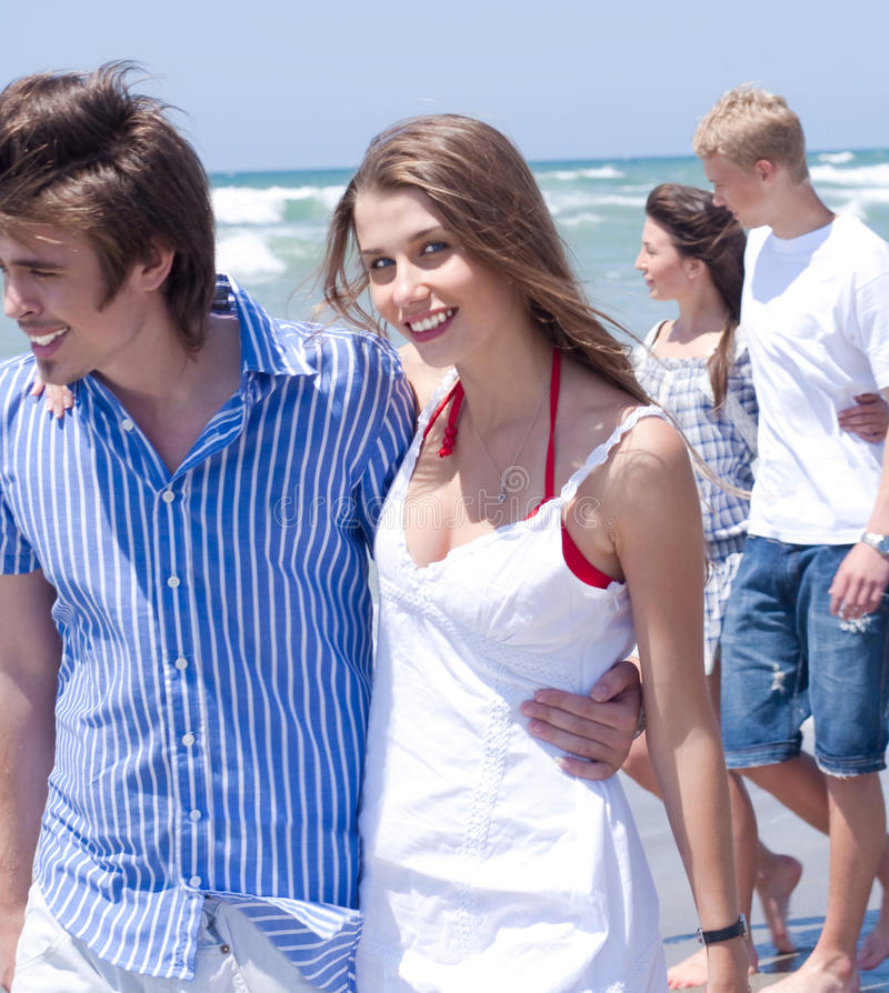 Download Happy Young Couples Walking At The Beach Royalty Free Stock Images - Image: 14311509