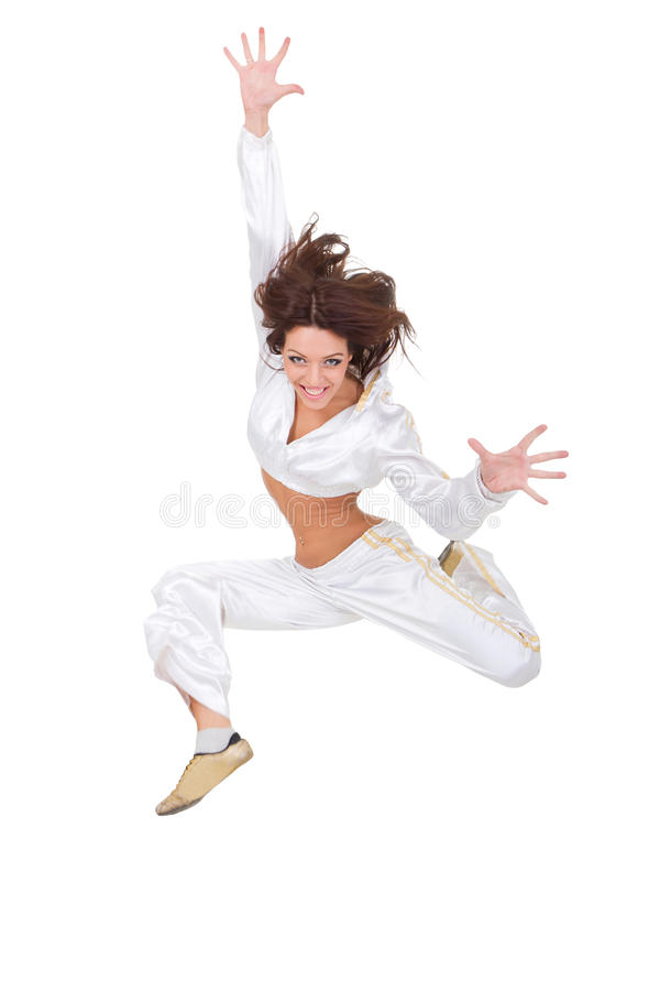 Happy young dancer jumping. Against isolated white background stock photography
