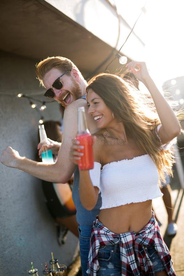 Happy young dancing couple having fun and enjoying party at summer royalty free stock photos